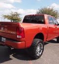dodge ram 1500 2009 orange slt sport gasoline 8 cylinders 4 wheel drive automatic 75075