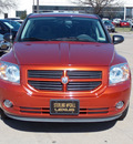 dodge caliber 2007 orange hatchback sxt gasoline 4 cylinders front wheel drive cont  variable trans  77074