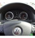 volkswagen tiguan 2010 silver suv se gasoline 4 cylinders front wheel drive automatic 33157