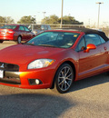 mitsubishi eclipse spyder 2012 orange gs sport gasoline 4 cylinders front wheel drive shiftable automatic 77074