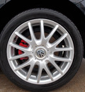 volkswagen jetta 2006 black sedan gli gasoline 4 cylinders front wheel drive shiftable automatic 77074