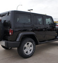 jeep wrangler unlimited 2012 black suv sahara gasoline 6 cylinders 4 wheel drive automatic 76011