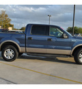 ford f 150 2004 dk  blue lariat gasoline 8 cylinders 4 wheel drive automatic 78130