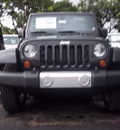 jeep wrangler unlimited 2012 black suv sahara gasoline 6 cylinders 4 wheel drive automatic 33157