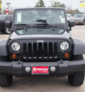 jeep wrangler unlimited 2010 black suv rubicon gasoline 6 cylinders 4 wheel drive automatic 77388