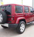 jeep wrangler unlimited 2012 red suv sahara gasoline 6 cylinders 4 wheel drive automatic 77388