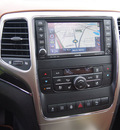 jeep grand cherokee 2012 gold suv overland summit gasoline 8 cylinders 4 wheel drive automatic 75067