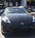 nissan 370z 2013 black coupe nismo gasoline 6 cylinders rear wheel drive standard 77477
