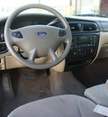 ford taurus 2002 beige sedan se gasoline 6 cylinders front wheel drive automatic 75110