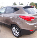 hyundai tucson 2013 brown limited gasoline 4 cylinders front wheel drive automatic 77074