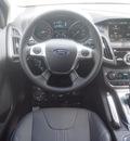 ford focus 2014 black hatchback titanium flex fuel 4 cylinders front wheel drive automatic 75235