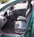 chevrolet aveo 2004 green hatchback ls gasoline 4 cylinders front wheel drive automatic 27330