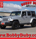 jeep wrangler unlimited 2008 silver suv sahara gasoline 6 cylinders 4 wheel drive automatic 79110