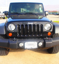 jeep wrangler unlimited 2010 black suv sport gasoline 6 cylinders 4 wheel drive automatic 77375
