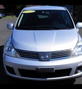 nissan versa 2009 silver hatchback 1 8 s gasoline 4 cylinders front wheel drive automatic 06019