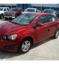 chevrolet sonic 2013 red sedan gasoline 4 cylinders front wheel drive 6 spd auto mylink touch lpo,all wthr flr mats lpo,cargo net 77090