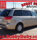 toyota sienna 2008 tan van le 8 passenger gasoline 6 cylinders front wheel drive automatic 79110