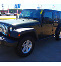jeep wrangler unlimited 2011 green suv sport gasoline 6 cylinders 4 wheel drive 6 speed manual 77375