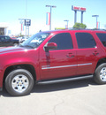 chevrolet tahoe 2011 red suv ls 8 cylinders automatic 79925