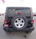 jeep wrangler unlimited 2012 black suv sport gasoline 6 cylinders 4 wheel drive 6 speed manual 60915